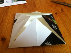 5.  Folding the points into the centre.